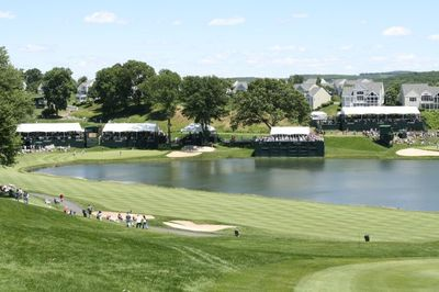 Far view of a crowd watching golf